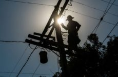 power worker on pole