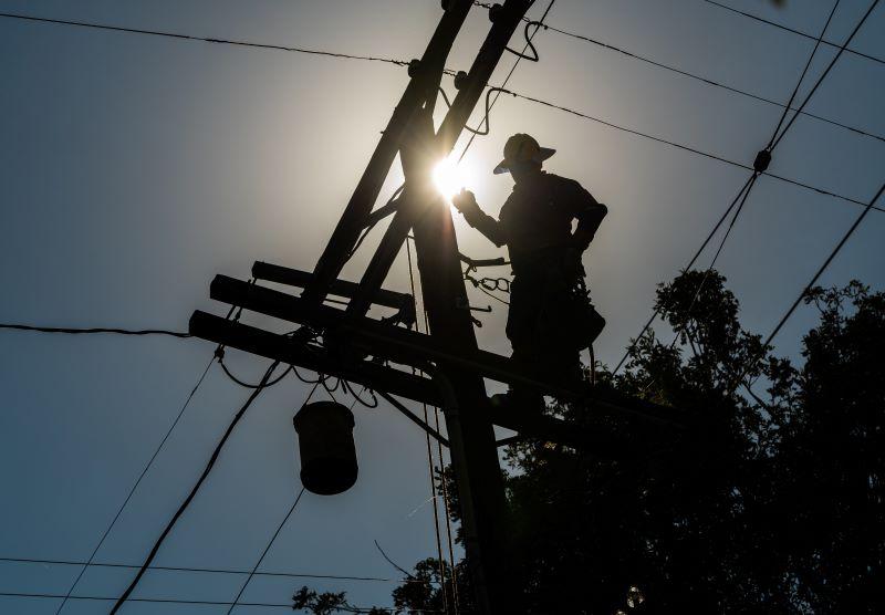 power worker on pole
